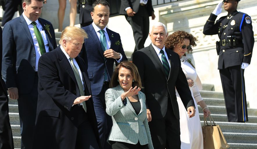 President Donald Trump, front left, together with Irish Prime Minister Leo Varadkar, back center, and Vice President Mike Pence, speaks to House Speaker Nancy Pelosi of Calif, as they walk down the steps of the U.S. Capitol following a Friends of Ireland luncheon on Capitol Hill, in Washington, Thursday, March 14, 2019. (AP Photo/Manuel Balce Ceneta)