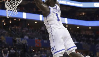 Duke's Zion Williamson (1) goes up to dunk against Syracuse during the first half of an NCAA college basketball game in the Atlantic Coast Conference tournament in Charlotte, N.C., Thursday, March 14, 2019. (AP Photo/Nell Redmond)
