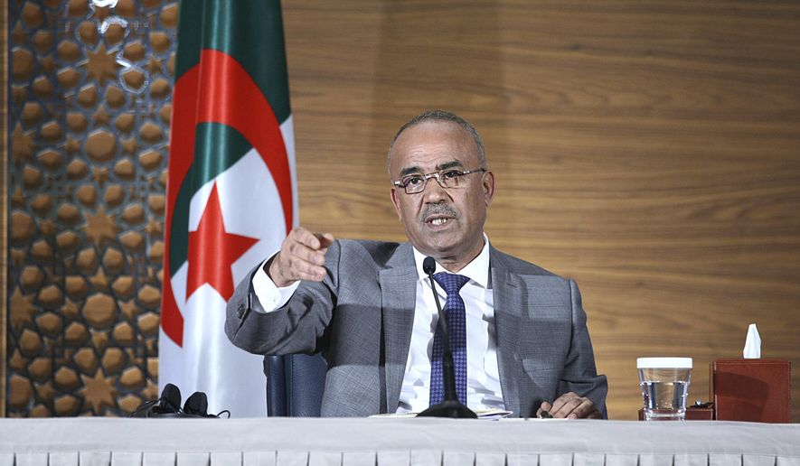 Algeria's new prime minister Noureddine Bedoui gives a press conference, in Algiers, Algeria, Thursday, March 14, 2019. Algeria's new prime minister is promising to create a government within days as the country faces mass protests calling on President Abdelaziz Bouteflika to step down. (AP Photo/Anis Belghoul)