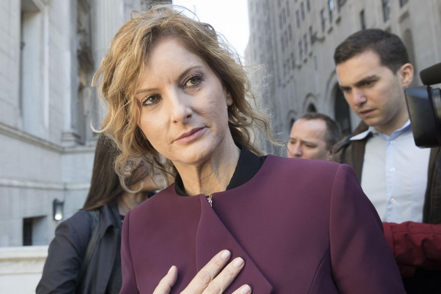 """In this Oct. 18, 2018 file photo, Summer Zervos leaves New York state appellate court in New York. A New York appeals court has ruled that President Donald Trump isn't immune from a defamation lawsuit filed by the former """"Apprentice"""" contestant who accused him of unwanted kissing and groping. (AP Photo/Mary Altaffer, FILE)"""