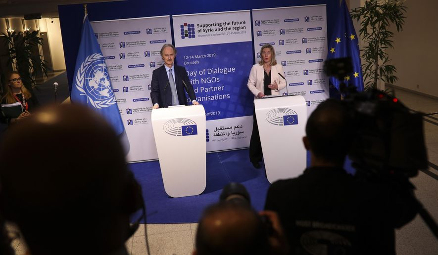 European Union foreign policy chief Federica Mogherini, right, and UN Syria envoy Geir Pedersen talk to journalists at the European Parliament on the eve of the Syria donors conference, in Brussels, Wednesday, March 13, 2019. Top officials are warning that the crisis in Syria is not over and are calling for large-scale support for people in need on the eve of a major donor's conference. (AP Photo/Francisco Seco)