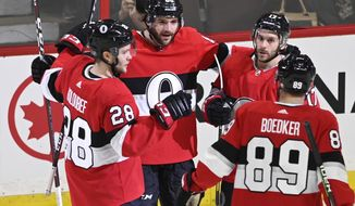 Ottawa Senators defenseman Christian Wolanin (86) celebrates his goal against the St. Louis Blues during second-period NHL hockey game action in Ottawa, Ontario, Thursday March 14, 2019. (Justin Tang/The Canadian Press via AP)