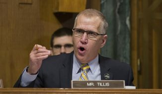 In this March 6, 2019, file photo, Sen. Thom Tillis, R-N.C., questions U.S. Customs and Border Protection Commissioner Kevin McAleenan (not shown) during a hearing of the Senate Judiciary Committee. (AP Photo/Alex Brandon) ** FILE **