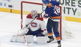 Montreal Canadiens goaltender Carey Price (31) makes a save against New York Islanders left wing Andrew Ladd (16) during the third period of an NHL hockey game, Thursday, March 14, 2019, in Uniondale, N.Y. (AP Photo/Mary Altaffer)