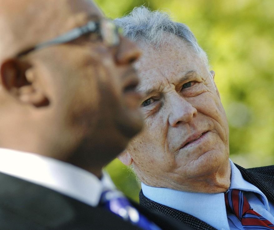 In this Tuesday, Sept. 6, 2011, file photo, Morris Dees (right) with the Southern Poverty Law Center, right, listens during a news conference, at the Hinds County Courthouse in Jackson, Miss. The Alabama-based Southern Poverty Law Center, a nationally known nonprofit that monitors hate organizations, said Thursday, March 14, 2019, it had fired co-founder Morris Dees, who once won a lawsuit that bankrupted a leading Ku Klux Klan group. (Joe Ellis/The Clarion-Ledger via AP, File)