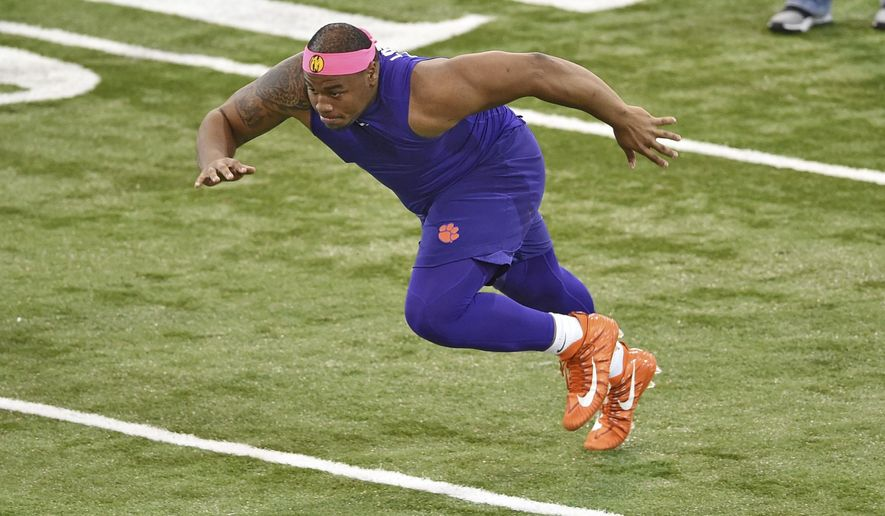 Clemson's Dexter Lawrence runs drills during NFL Pro Day, Thursday, March 14, 2019, in Clemson, S.C. (AP Photo/Richard Shiro)