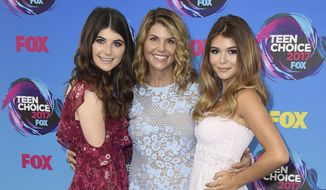 Actress Lori Loughlin, center, poses with her daughters Bella, left, and Olivia Jade at the Teen Choice Awards in Los Angeles. (Photo by Jordan Strauss/Invision/AP, File)