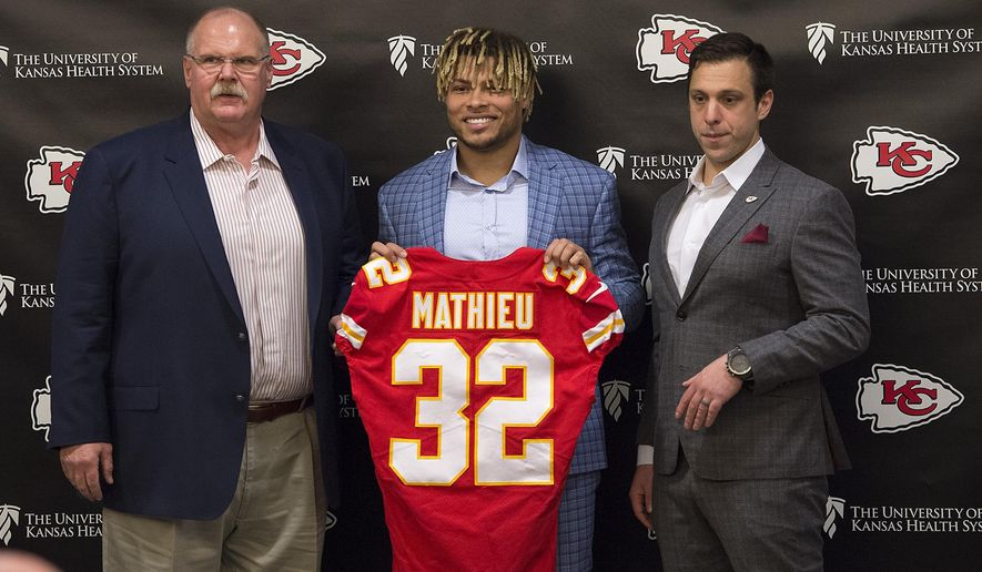 Kansas City Chiefs head coach Andy Reid, left, and general manager Brett Veach, right, introduce new safety Tyrann Mathieu during an NFL football news conference Thursday, March 14, 2019 at the team's practice facility in Kansas City, Mo. (Tammy Ljungblad/The Kansas City Star via AP)