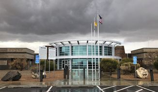 This March 12, 2019, photo shows the Metropolitan Detention Center of Bernalillo County outside of Albuquerque, N.M. The has come under criticism after it was revealed late last month that its records department was allowing federal immigration authorities to access its inmate database. (AP Photo/Russell Contreras)