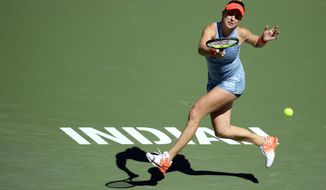 Belinda Bencic, of Switzerland, returns a shot to Karolina Pliskova, of the Czech Republic, at the BNP Paribas Open tennis tournament Thursday, March 14, 2019, in Indian Wells, Calif. (AP Photo/Mark J. Terrill)