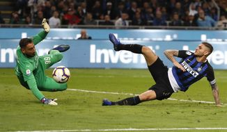 FILE - In this Sunday, Oct. 21, 2018 file photo, Inter Milan's Mauro Icardi, right, tries to score over AC Milan goalkeeper Gianluigi Donnarumma during the Serie A soccer match between Inter Milan and AC Milan at the San Siro Stadium, in Milan, Italy. Just five months after beating AC Milan a derby defeat could leave crisis-hit Inter Milan in danger of missing out on the Champions League. Icardi scored a stoppage-time winner in the October derby but he has not played in more than a month, since being stripped off his captaincy amid protracted contract negotiations. Icardi's downfall and Krzysztof Piatek's arrival at Milan from Genoa means the two sides approach the second derby of the season in very different moods to the first. (AP Photo/Antonio Calanni, File)