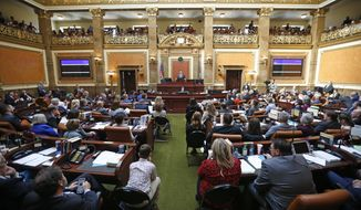 FILE - In this Jan. 28, 2019, file photo, the floor of the Utah House of Representatives is shown during the first day of the Utah legislative session, in Salt Lake City. Utah lawmakers were set Thursday, March 14, 2019, to end their annual legislative session after scaling back a voter-approved Medicaid expansion, passing a long-awaited update to the state's hate crimes law and reaching a deal to increase the alcohol level in beer. Measures on other hot-button issues failed to pass, like a ban on LGBT conversion therapy. Lawmakers also passed two anti-abortion measures. (AP Photo/Rick Bowmer, File)