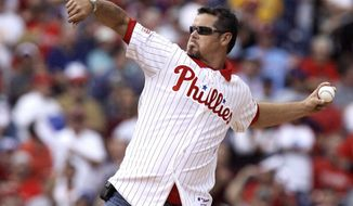 FILE - In this Oct. 1, 2008, file photo, former Philadelphia Phillies pitcher Mitch Williams throws out the ceremonial first pitch before the start of Game 1 of the National League division baseball series between the Phillies and the Milwaukee Brewers in Philadelphia. A New Jersey appeals court has upheld a $1.5 million jury award to Williams over his firing by the MLB Network. An MLB Network spokesman says the network is reviewing the ruling and assessing its option.  (AP Photo/Julie Jacobson, File)
