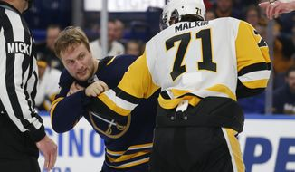 Buffalo Sabres forward John Larsson (22) and Pittsburgh Penguins forward Evgeni Malkin (81) fight during the third period of an NHL hockey game Thursday, March 14, 2019, in Buffalo, N.Y. (AP Photo/Jeffrey T. Barnes)