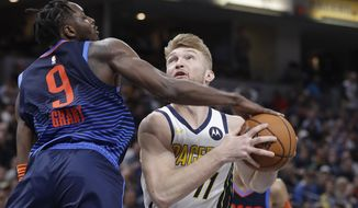 Indiana Pacers' Domantas Sabonis (11) puts up a shot against Oklahoma City Thunder's Jerami Grant (9) during the second half of an NBA basketball game, Thursday, March 14, 2019, in Indianapolis. Indiana won 108-106. (AP Photo/Darron Cummings)