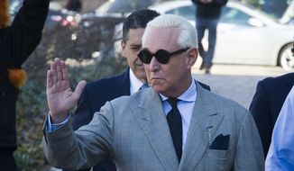 Roger Stone, an associate of President Donald Trump, arrives at the U.S. District Court, for a court status conference on his seven charges: one count of obstruction of an official proceeding, five counts of false statements, and one count of witness tampering, in Washington, Thursday, March 14, 2019. Stone has pleaded not guilty to the charges. (AP Photo/Cliff Owen) ** FILE **
