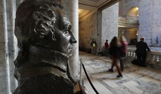 In this Tuesday, March 12, 2019 photo, a bust of George Washington looks over a hallway in the rotunda at the Capitol in Olympia, Wash. Washington lawmakers are now more than halfway through a 105-day legislative session that has so far included debate over a public health insurance option, raising the smoking age, and tightening rules on school vaccination exemptions. (AP Photo/Ted S. Warren)