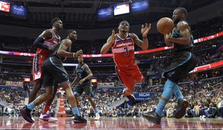 Washington Wizards guard Bradley Beal (3) battles for the ball with Charlotte Hornets guard Kemba Walker, right, during the first half of an NBA basketball game, Friday, March 15, 2019, in Washington. Also seen are forward Wizards forward Bobby Portis, right, and Charlotte Hornets forward Marvin Williams (2) and guard Dwayne Bacon, second from left. The Hornets won 116-110. (AP Photo/Nick Wass)