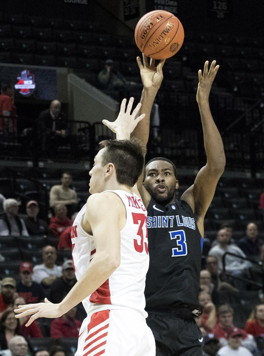 Saint Louis guard Javon Bess (3) shoots a 3-point basket over Dayton forward Ryan Mikesell (33) during the second half of an NCAA college basketball game in the Atlantic 10 Conference tournament, Friday, March 15, 2019, in New York. (AP Photo/Mary Altaffer)