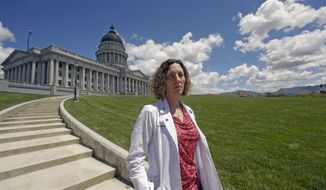 FILE - In this May 10, 2016, file photo, Dr. Leah Torres, an obstetrician-gynecologist, poses for a photo at the Utah State Capitol in Salt Lake City. Torres, a well-known abortion rights activist from Utah has filed a lawsuit on Wednesday, March 13, 2019 against three conservative media publications for defamation, says that online stories spread misinformation that she cut the throats of fetuses during abortions. (AP Photo/Rick Bowmer, File)