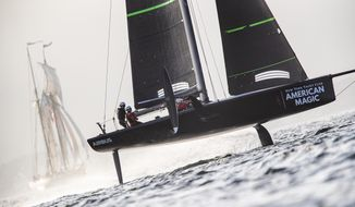 In a photo provided by New York Yacht Club's American Magic, American Magic's test boat knowns as the Mule undergoes training Feb. 23, 2019, at Pensacola, Fla. American Magic is the only one of the seven teams for the 2021 America's Cup that has built the closest thing allowed by the rules to what the actual race boat, the AC75, will look and perform like. American Magic is building its first AC75 in Rhode Island and expects it to be finished by the middle of the summer. (Armory Ross/NYYC American Magic via AP)