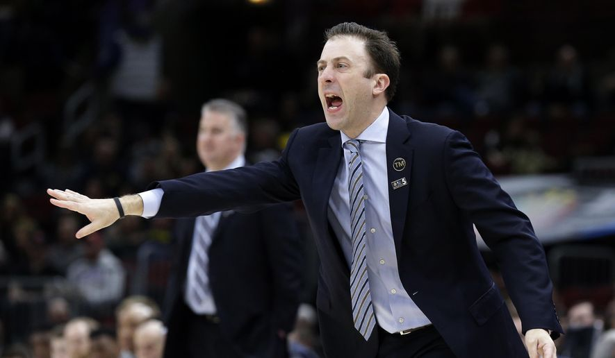 Minnesota head coach Richard Pitino directs his team during the first half of an NCAA college basketball game against Purdue in the quarterfinals of the Big Ten Conference tournament, Friday, March 15, 2019, in Chicago. (AP Photo/Kiichiro Sato) **FILE**