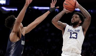 Seton Hall guard Myles Powell (13) shoots against Georgetown guard Jamorko Pickett during the first half of an NCAA college basketball game in the Big East men's tournament, Thursday, March 14, 2019, in New York. (AP Photo/Julio Cortez) ** FILE **