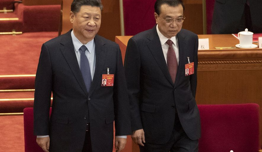 Chinese President Xi Jinping and Chinese Premier Li Keqiang arrive for the closing session of the National People's Congress in Beijing's Great hall of the People on Friday, March 15, 2019. (AP Photo/Ng Han Guan)