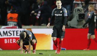 Sevilla players react to losing their Europa League Round of 16 second leg soccer match between Slavia Praha and Sevilla at the Sinobo stadium in Prague, Czech Republic, Thursday, March 14, 2019. (AP Photo/Petr David Josek)