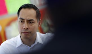 FILE - In this Feb. 28, 2019 file photo, former Housing and Urban Development Secretary and Democratic presidential candidate Julian Castro visits with people at a taco truck in North Las Vegas, Nev. Democratic presidential candidate Julian Castro says the Latino community's bilingual, ambitious youth are one of America's best assets to remain competitive in the world. Castro made the comments at a luncheon Friday, March 15, 2019, before Latino business leaders in Las Vegas as he made his third visit to Nevada as a 2020 hopeful. (AP Photo/John Locher, File)