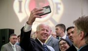 Former Vice President Joe Biden takes a photograph with members of the audience after speaking to the International Association of Firefighters at the Hyatt Regency on Capitol Hill in Washington, Tuesday, March 12, 2019, amid growing expectations he'll soon announce he's running for president. (AP Photo/Andrew Harnik)