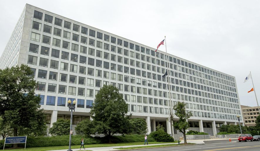 """This Friday, June 19, 2015, file photo shows the Department of Transportation Federal Aviation Administration building, in Washington. For more than six decades, the Federal Aviation Administration has relied on employees of airplane manufacturers to do government-required safety inspections as planes are being designed or assembled. But critics say the system, dubbed the """"Designee Program,"""" is too cozy as company employees do work for an agency charged with keeping the skies safe while being paid by an industry that the FAA is regulating. (AP Photo/Andrew Harnik, File)"""