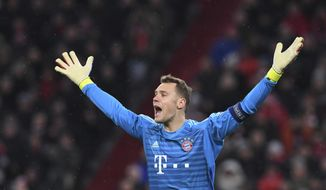 Bayern goalkeeper Manuel Neuer reacts during the Champions League round of 16 second leg soccer match between Bayern Munich and Liverpool at the Allianz Arena, in Munich, Germany, Wednesday, March 13, 2019. (AP Photo/Kerstin Joensson)