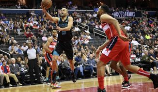 Charlotte Hornets guard Tony Parker (9) goes to the basket against Washington Wizards forward Jabari Parker, right, during the first half of an NBA basketball game, Friday, March 15, 2019, in Washington. (AP Photo/Nick Wass)