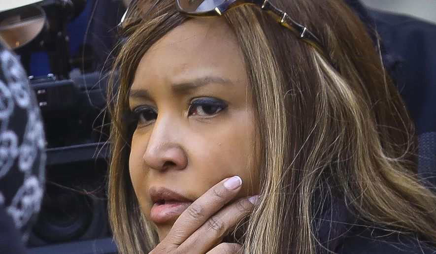 In this March 6, 2019 photo, HUD executive Lynne Patton listens as a resident at the New York City Housing Authority's Queensbridge Houses in New York complains about conditions in her apartment. Patton says she wanted to shine a spotlight on public housing ills such as mold and heat and hot water outages by spending a week at a time in four different complexes run by the New York City Housing Authority. (AP Photo/Bebeto Matthews) **FILE**