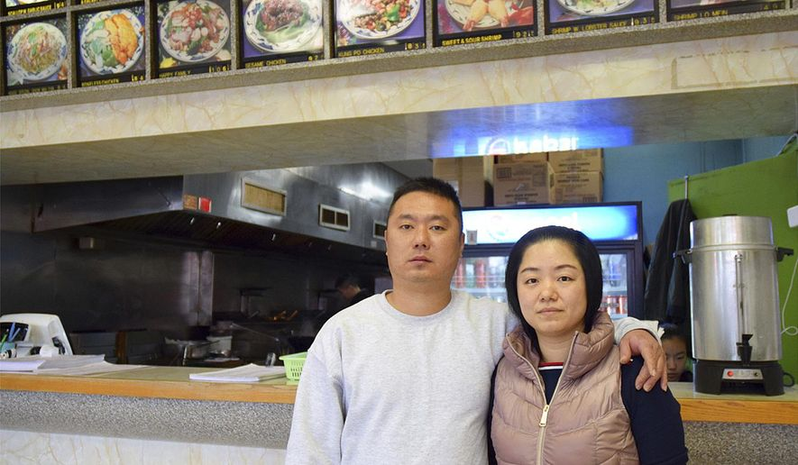 In this undated photo released by Amber Taylor, Wanrong Lin, left, and his wife, Hui Fang Dong, pose for a photo. Wanrong Lin, a Maryland resident whose deportation was blocked by a federal judge while he was on a flight in November to his native China is seeking a court order allowing him to remain in the U.S. with his family. U.S. District Judge George Hazel is scheduled to hear arguments Friday, March 15, 2019, from attorneys for Wanrong Lin and the federal government. (Amber Taylor via AP)