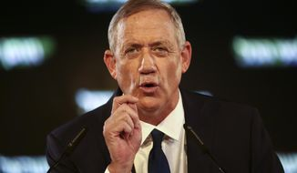 FILE - In this Tuesday, Jan. 29, 2019, file photo, former Israeli Chief of Staff Benny Gantz speaks at the official launch of his election campaign in Tel Aviv, Israel. enny Gantz's campaign late Thursday confirmed that the tough former military chief, who has been campaigning on his impeccable security credentials, was the target of an Iranian hacking attack several months ago. (AP Photo/Oded Balilty, File)