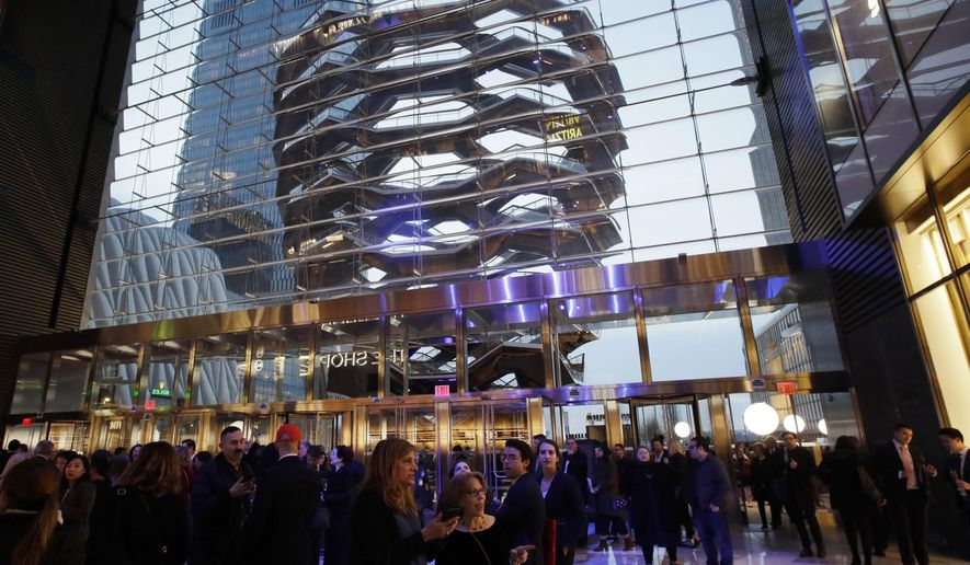 a8d3f7334ebc People attend the opening of the Neiman Marcus department store during the  opening night of The Shops & Restaurants at Hudson Yards, Thursday, March  14, ...
