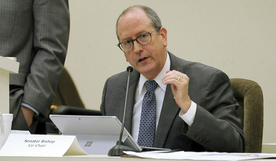 FILE - In this Jan. 22, 2018 file photo, N.C. Sen. Dan Bishop speaks during a joint N.C. House-Senate committee meeting on judicial reform and redistricting held at the Legislative Office Building in downtown Raleigh, N.C.  Bishop of Charlotte filed on Thursday, March 14, 2019 to run in the 9th Congressional District re-do election. He faces at least two others in May's Republican primary. (Chris Seward/The News & Observer via AP)