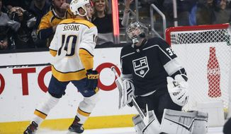 Nashville Predators forward Colton Sissons (10) celebrates after scoring on Los Angeles Kings goalie Jonathan Quick (32) during the second period of an NHL hockey game Thursday, March 14, 2019, in Los Angeles. (AP Photo/Ringo H.W. Chiu)