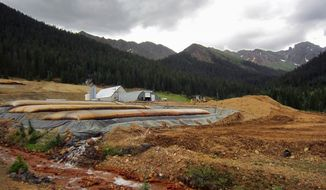 FILE - This July 27, 2017 file photo shows a U.S. Environmental Protection Agency wastewater treatment plant in the San Juan Mountains outside Silverton, Colo. Effects of a storm that struck the area Wednesday, March 13, 2019 were still being felt, as fluctuating electrical power knocked the plant offline Thursday night, and an avalanche blocked the access road to the facility. (AP Photo/Dan Elliott, File)