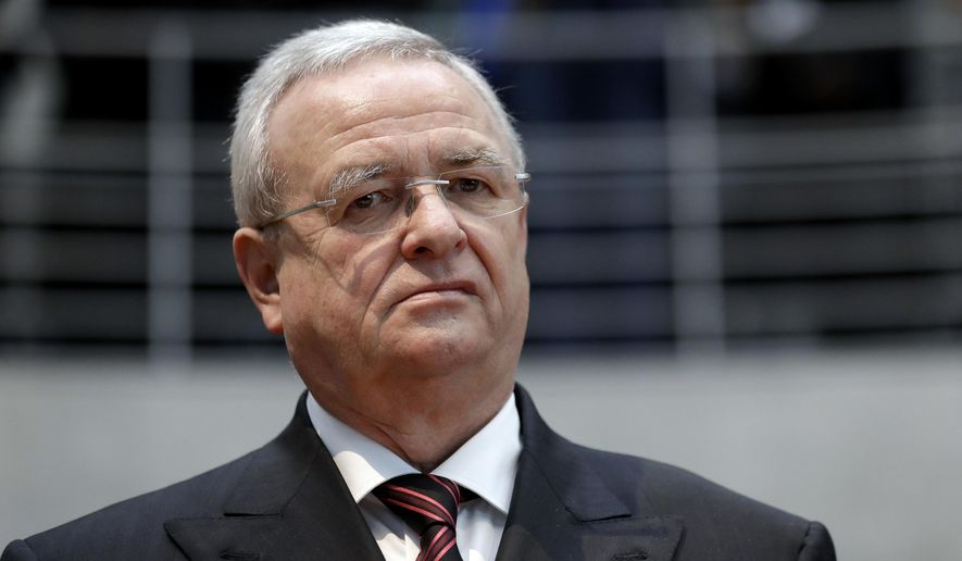 FILE - In this Jan. 19, 2017 file photo Martin Winterkorn, former CEO of the German car manufacturer 'Volkswagen', arrives for a questioning at an investigation committee of the German federal parliament in Berlin, Germany.  The Securities and Exchange Commission is charging Volkswagen and former CEO Martin Winterkorn with defrauding American investors during an emissions scandal. The SEC said that between April 2014 and May 2015 Volkswagen issued more than $13 billion in bonds and asset-backed securities in U.S. markets when senior executives knew that more than 500,000 vehicles in the country grossly exceeded legal vehicle emissions limits.  (AP Photo/Michael Sohn, file)