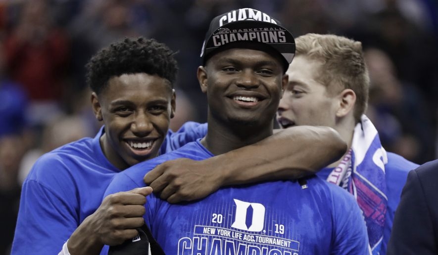 Duke's RJ Barrett, left, hugs Zion Williamson after Duke defeated Florida State in the NCAA college basketball championship game of the Atlantic Coast Conference tournament in Charlotte, N.C., Saturday, March 16, 2019. (AP Photo/Chuck Burton) **FILE**