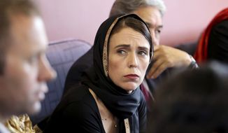 """In this photo released by New Zealand Prime Minister's Office, Prime Minister Jacinda Ardern, center, meets representatives of the Muslim community, Saturday, March 16, 2019 at the Canterbury Refugee Centre in Christchurch, New Zealand. New Zealand's prime minister says the """"primary perpetrator"""" in the killing of at least 49 people in two Christchurch mosques was living in Dunedin, a seaside city south of Christchurch. (New Zealand Prime Minister Office via AP)"""