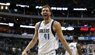 Dallas Mavericks forward Dirk Nowitzki argues a foul call during the second half of the team's NBA basketball game against the Cleveland Cavaliers in Dallas, Saturday, March 16, 2019. (AP Photo/Michael Ainsworth) **FILE**