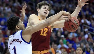 Kansas forward Dedric Lawson (1) blocks a shot by Iowa State forward Michael Jacobson (12) during the second half of an NCAA college basketball game in the final of the Big 12 men's tournament in Kansas City, Mo., Saturday, March 16, 2019. (AP Photo/Orlin Wagner)