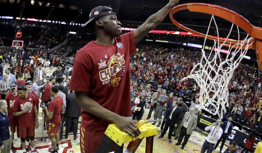 Iowa State's Terrence Lewis holds a piece of the net after Iowa State defeated Kansas 78-66 in an NCAA college basketball game to win the Big 12 men's tournament Saturday, March 16, 2019, in Kansas City, Mo. (AP Photo/Charlie Riedel)