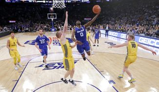Seton Hall guard Quincy McKnight (0) goes up for a shot against Marquette forward Joey Hauser (22) during the first half of an NCAA college basketball semifinal game in the Big East men's tournament, Friday, March 15, 2019, in New York. (AP Photo/Julio Cortez)