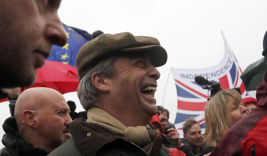 """Former UKIP party leader Nigel Farage joins the start of the first leg of March to Leave the European Union, in Sunderland, England, Saturday, March 16, 2019. Hard-core Brexiteers led by former U.K. Independence Party leader Nigel Farage set out on a two-week """"Leave Means Leave"""" march between northern England and London, accusing politicians of """"betraying the will of the people."""" (AP Photo/Frank Augstein)"""