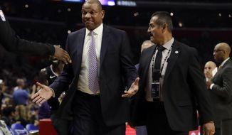 Los Angeles Clippers head coach Doc Rivers is escorted off the court after being ejected from an NBA basketball game against the Chicago Bulls Friday, March 15, 2019, in Los Angeles. (AP Photo/Marcio Jose Sanchez)